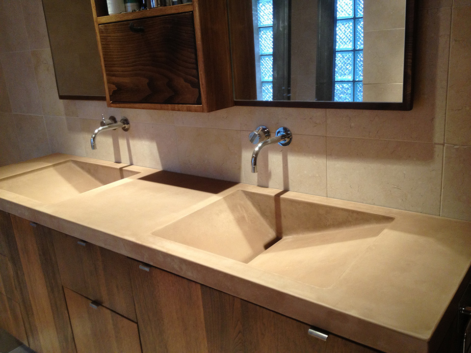 Concrete double sink with walnut cabinetry